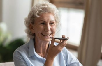 Grandmother using cell phone ECA Hearing Aid